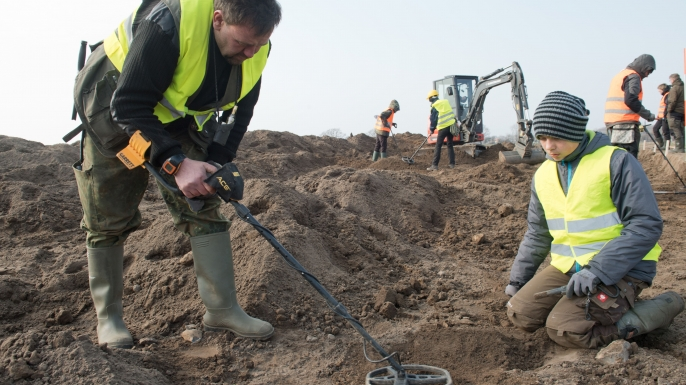 Amateur archaeologist Rene Schoen and 13-year-old student Luca Malaschnichenko looking for treasure with a metal detector in Schaprode, northern Germany on April 13, 2018. (Credit: Stefan Sauer/AFP/Getty Images)