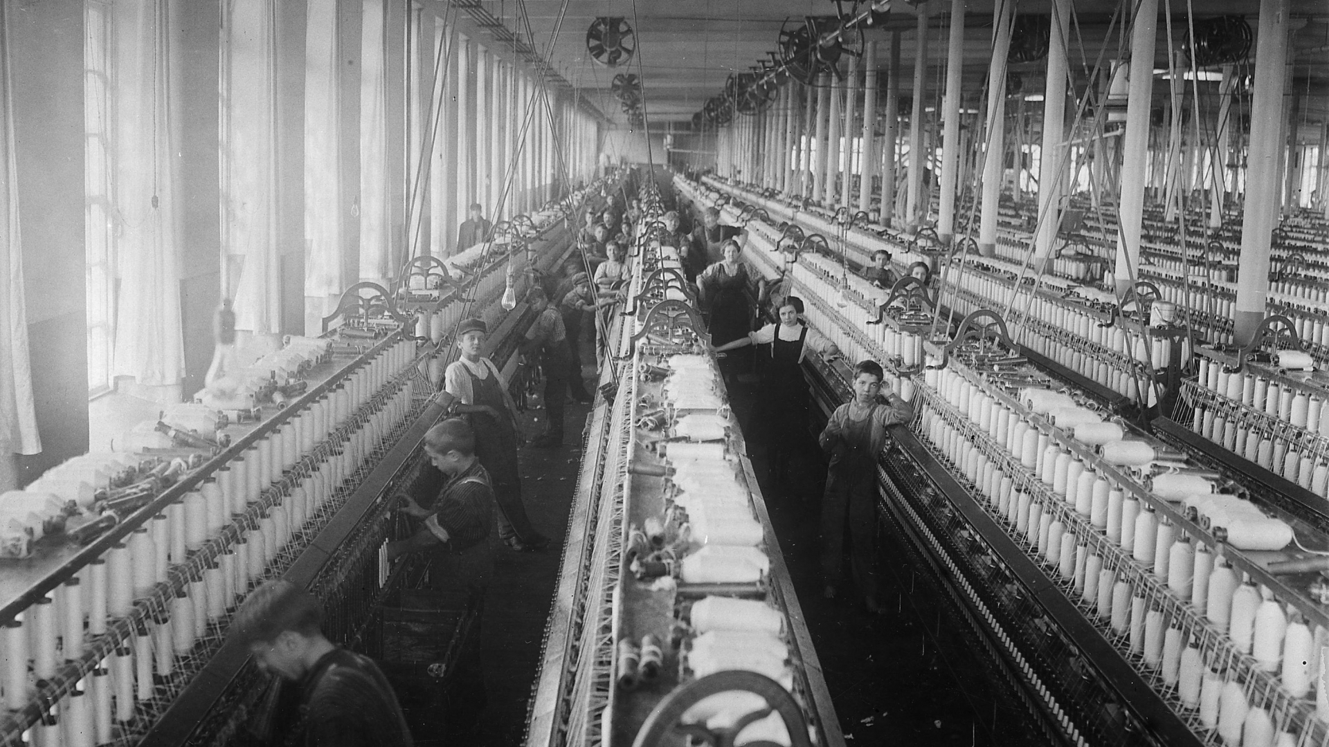 General view of a spinning room at the Cornell Mill in Fall River, Massachusetts, January 1912. (Credit: Lewis Hine/The U.S. National Archives)