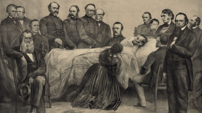Military commanders and cabinet members surround Abraham Lincoln on his death bed, while his wife Mary Todd Lincoln kneels at his side, on April 15, 1865. (Credit: Everett Collection)