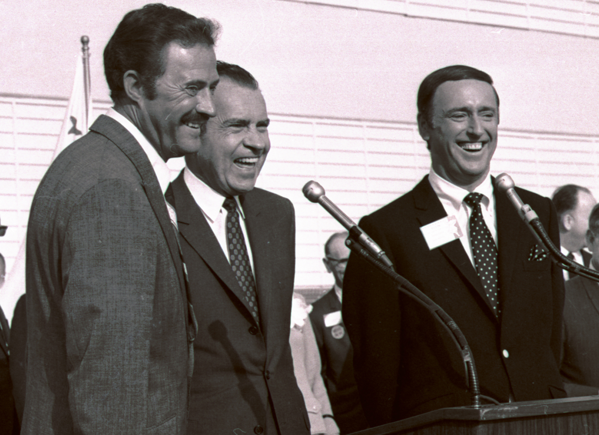 Comedians Dan Rowan, left, and Dick Martin, hosts of 'Rowan & Martin's Laugh-In' with then-Republican presidential candidate Richard Nixon during a rally in Burbank, California, October 1968. (Credit: AP Photo)