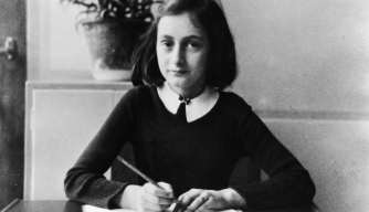 Anne Frank doing her homework in 1941. (Photo by ADN-Bildarchiv/ullstein bild via Getty Images)