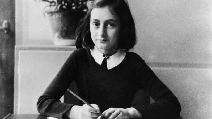 Anne Frank doing her homework in 1941. (Photo by ADN-Bildarchiv/ullstein bild via Getty Images)