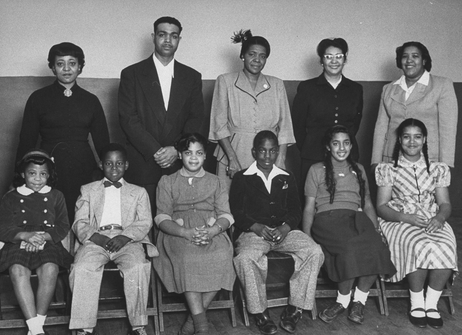 The students for whom the famous Brown v. Board of Education case was brought, with their parents (L-R) Zelma Henderson, Oliver Brown, Sadie Emanuel, Lucinda Todd, and Lena Carper, 1953. (Credit: Carl Iwasaki/The LIFE Images Collection/Getty Images)