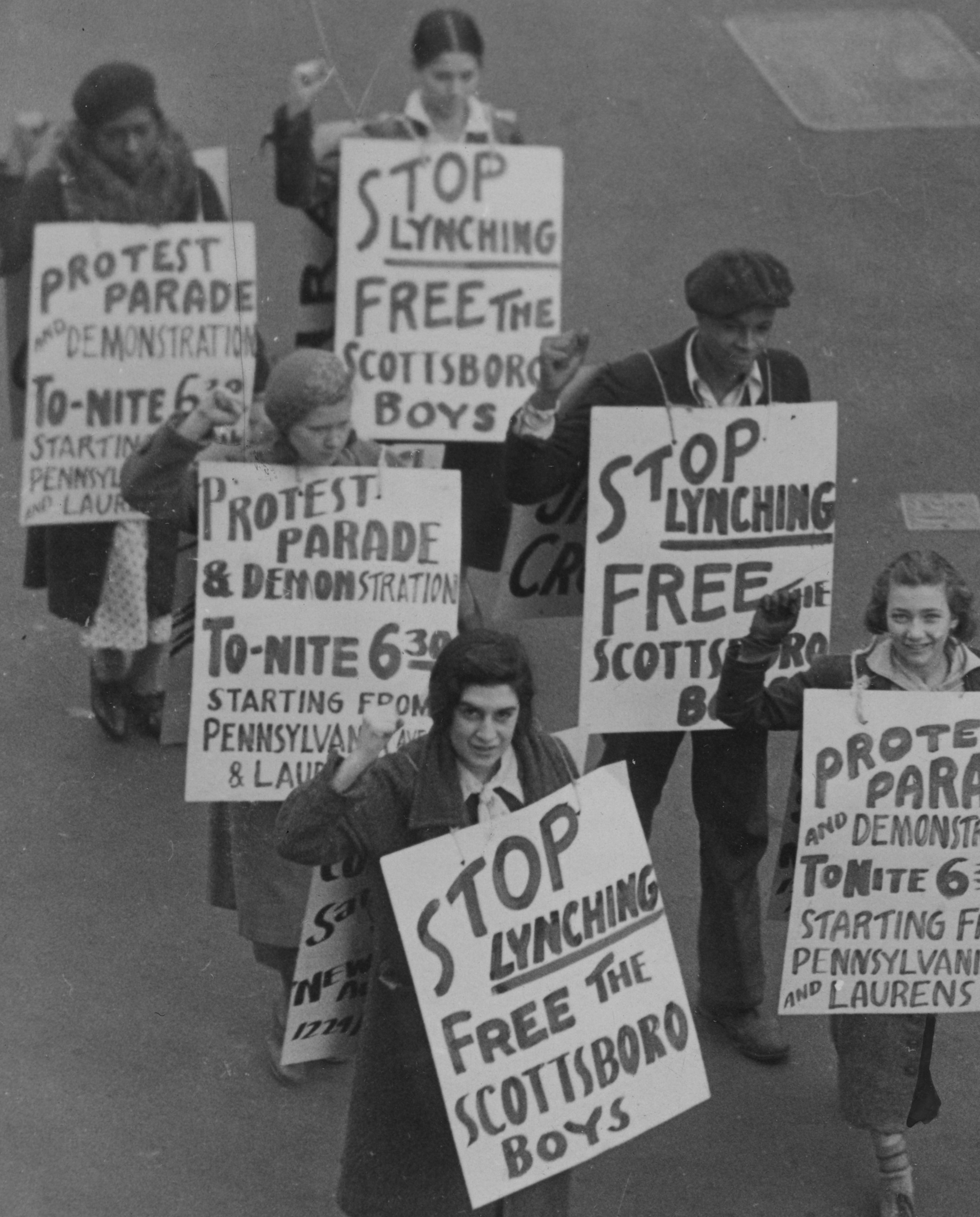 Members of the Communist Party of the United States' preparing for a march to protest the conviction of the Scottsboro boys, 1933. (Credit: Afro American Newspapers/Gado/Getty Images)