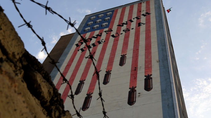 Anti-U.S. graffiti seen decorating the wall of a building in Tehran, 2015. (Credit: Atta Kenare/AFP/Getty Images)