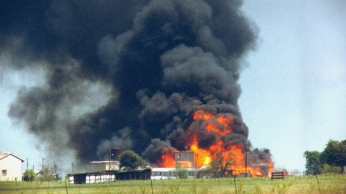 Fire and smoke consuming the David Koresh-led Branch Davidian cult compound, 1993.  (CREDIT: Mark Perlstein/The LIFE Images Collection/Getty Images)