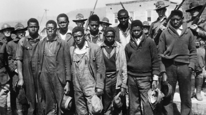 The accused Scottsboro Boys (left to right): Clarence Norris, Olen Montgomery, Andy Wright, Willie Roberson, Ozie Powell, Eugene Williams, Charlie Weems, Roy Wright, and Haywood Patterson. (Credit: Bettmann Archive/Getty Images)