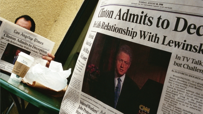People in a California coffee shop read the Los Angeles Times the day after President Bill Clinton admitted to having a relationship with Monica Lewinsky. (Credit: David Butow/Corbis/Getty Images)