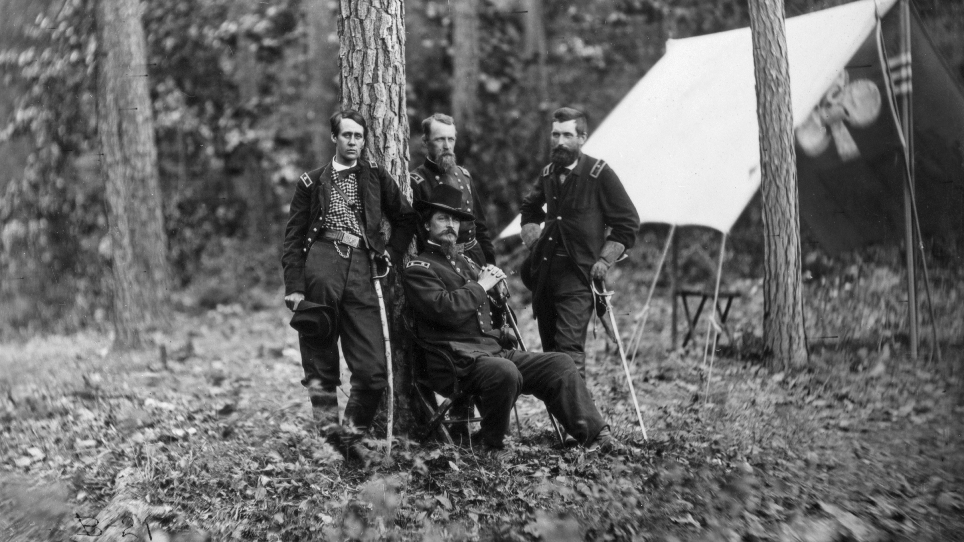 Portrait of General Winfield Scott Hancock (1824-1886), a Federal officer during the American Civil War, with members of his staff. Left to right are Generals Francis C. Barlow, David B. Birney, Winfield S. Hancock (seated), and John Gibbon. Each of these officers was wounded during the Battle of Gettysburg. (Photo by © CORBIS/Corbis via Getty Images)